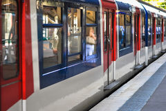 Commuter Train at Station Platform. Red White Blue Commuter Train at Station Platform Stock Photos
