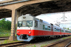 Commuter Train Under Bridge Royalty Free Stock Photo