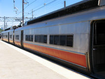 Commuter Train Waiting at Station. A commuter train with doors open, waiting at a station Royalty Free Stock Photos