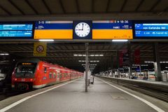 A commuter train waits at the Munich Main Railway Station (Munchen Hauptbahnhof) Royalty Free Stock Images
