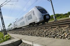 Commuter train zooming past Royalty Free Stock Photos