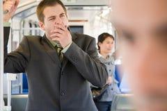 Commuter yawning Royalty Free Stock Photo