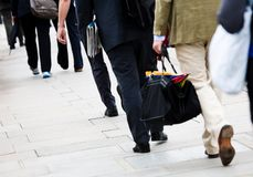 Commuters. In casual business dress walk to work Stock Images