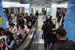 People arrive and depart on a platform, Shenzhen subway transport system underground station. Commuters arrive and depart on a platform at a Shenzhen subway stock images