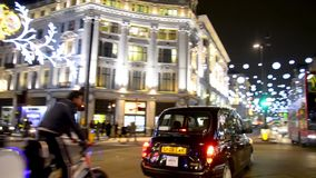 Commuters at christmas shopping with decorations on street in London, UK stock video