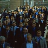 Commuters cross London Bridge Stock Photography
