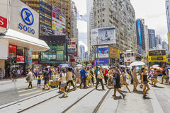 Commuters crossing the street in Causeway Bay Stock Image