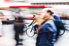 Commuters and cyclists in the city Royalty Free Stock Photo