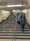 Commuters descend and ascend using stairs at Osaka Kita-Ku station city, Japan. OSAKA KITA-KU, OSAKA-SHI, JAPAN-NOVEMBER 10, 2018 : Commuters descend and ascend royalty free stock image