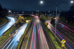 Commuters in Freeway Traffic at Night on Highway 520 Stock Images
