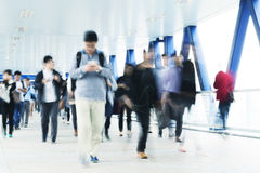 Commuters in Hong Kong. Motion blurred commuters in Hong Kong Royalty Free Stock Image