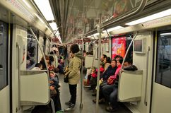 Commuters inside a Shanghai metro train railway carriage Royalty Free Stock Photo