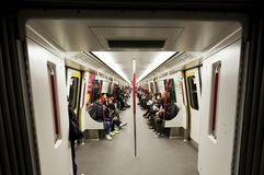 Commuters inside a subway train in Hong Kong Stock Images
