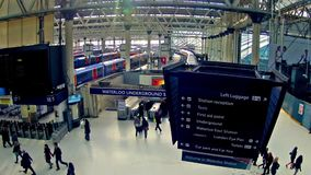 Commuters inside Waterloo Railway Station, London. LONDON, UNITED KINGDOM Top view panning timelapse of Commuters inside Waterloo Railway Station on December 1 stock video footage