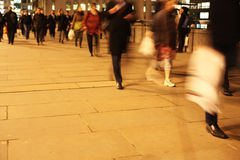 Commuters on London Bridge at night. Commuters at night on London Bridge, London, England Stock Photography