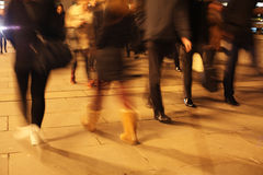 Commuters on London Bridge at night Royalty Free Stock Images