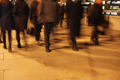 Commuters on London Bridge at night. Commuters at night on London Bridge, London, England Stock Photo
