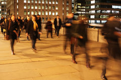 Commuters on London Bridge at night. Commuters at night on London Bridge, London, England Stock Photos