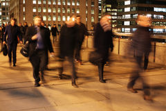 Commuters on London Bridge at night. Commuters at night on London Bridge, London, England Royalty Free Stock Photo