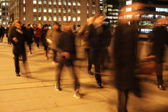 Commuters on London Bridge at night. Commuters at night on London Bridge, London, England Royalty Free Stock Photos