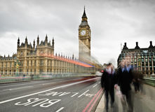 Commuters in London. Traffic and commuters crossing Westminster bridge. long exposure Royalty Free Stock Photo