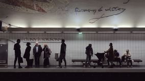 Commuters at metro station Cluny La Sorbonne in Paris. PARIS, FRANCE - SEPTEMBER 29, 2017: Young and senior people waiting for the subway train at the station stock video