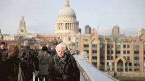 Commuters on Millenium Bridge Stock Photo