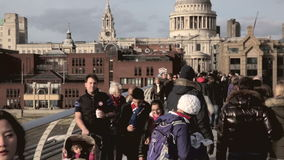 Commuters on Millenium Bridge Stock Images