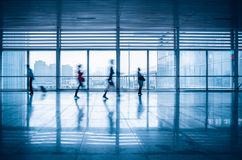 Commuters motion blurred in modern corridor Royalty Free Stock Photos
