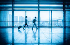 Commuters motion blurred in modern corridor Stock Image