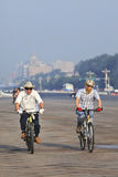 Commuters on mountain bikes with smog protection, Beijing, China Royalty Free Stock Photo