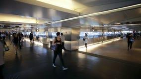 Commuters on a moving walking transiting hong kong central mtr station hong stock video