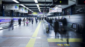 Commuters on a moving walkway in Shibuya station at rush hour shibuya stock video