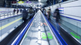 Commuters on a moving walkway in shibuya station at rush hour shibuya stock footage