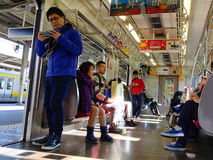 Commuters ride Tokyo metro transit system in Tokyo Stock Photo