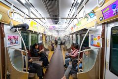 Commuters ride a train in subway. TOKYO, JAPAN - APRIL 25 2018: Commuters ride a train in subway in Tokyo stock photo