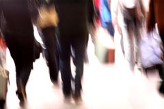 Commuters rush hour. A mirage of commuters in a hurry at terminal. In soft soft focus Royalty Free Stock Photos