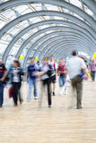 Commuters rushing in corridor, motion blur. A commuters rushing in corridor, motion blur Royalty Free Stock Image