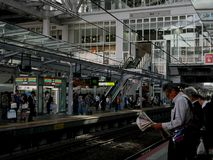 Waiting for the train. Commuters silently wait for the next train inside a station in Kansai, Japan Royalty Free Stock Images