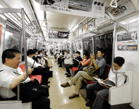 Commuters on a Subway Stock Photo