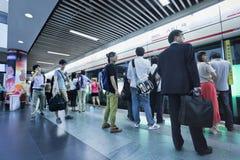 Commuters at a subway station, Shanghai, China Stock Photo