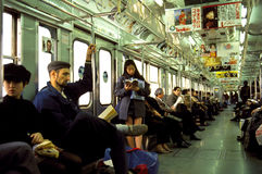 Commuters on Subway in Tokyo Stock Image
