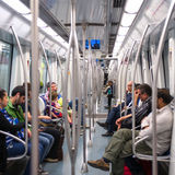 Commuters in subway wagon. Stock Image