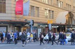 Commuters Sydney Australia. People cross street in front of Myer department store in Sydney Australia Stock Image
