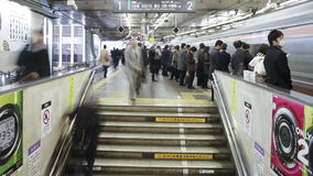 Commuters tmoving on an escalator in shibuya station at rush hour stock footage