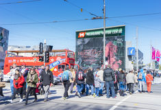 Commuters and tourists crossing the road outside the Melbourne Visitor Centre Royalty Free Stock Photography