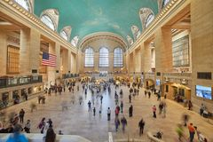 Commuters and tourists in grand central station stock images