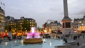 Commuters on Trafalgar square in London stock footage