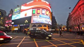 Commuters and traffic at Piccadilly circus UK stock video