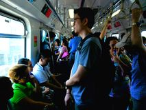 Commuters in a train. Passengers or commuters in a train called metro rail transit (mrt) and light rail transit (lrt) in manila, philippines, asia Stock Image